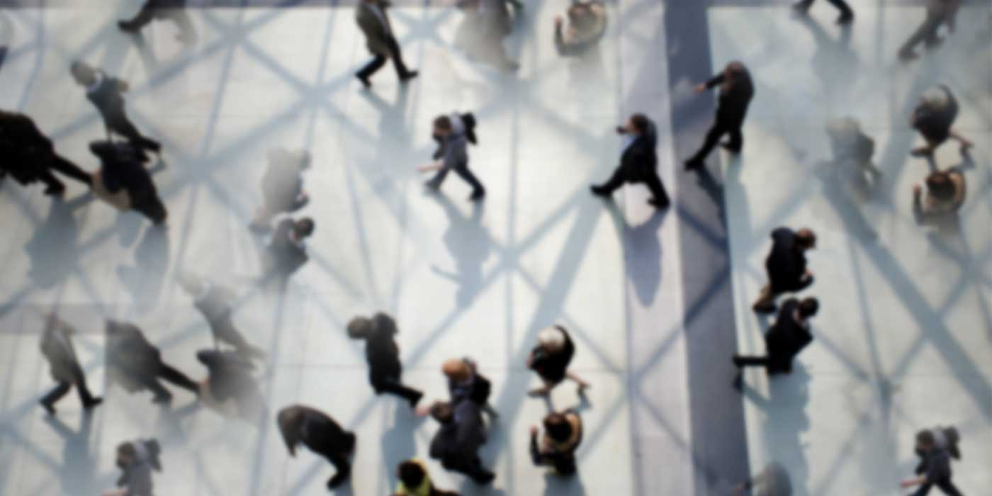 aerial view of crowd of workers walking